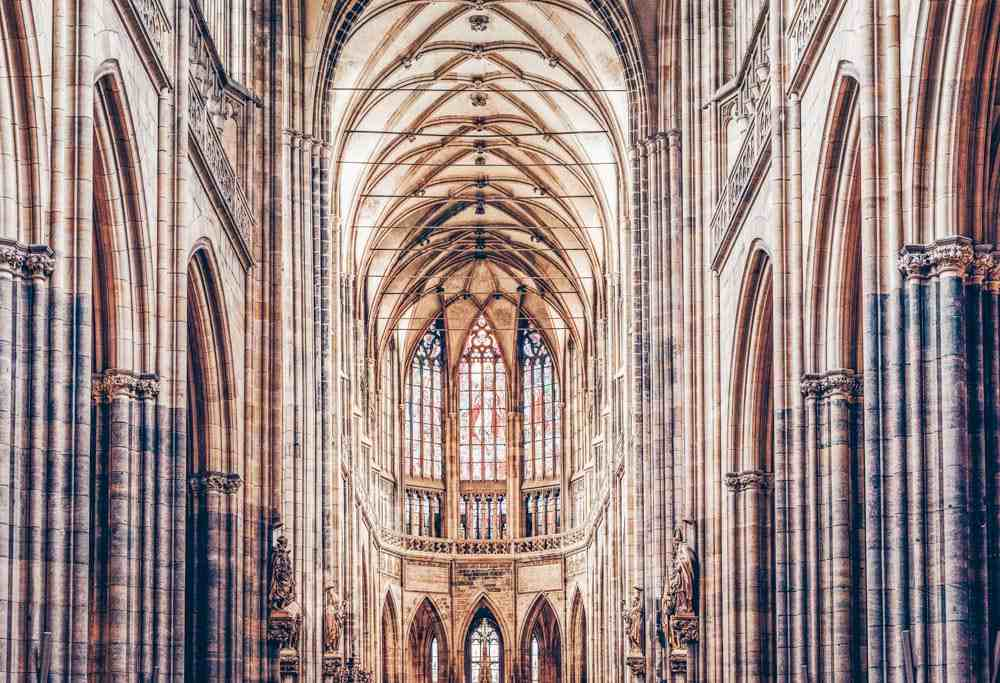 24 Hours in Prague: Gothic interior of St. Vitus Cathedral with stained glass.PC: Frimufilms/shutterstock.com