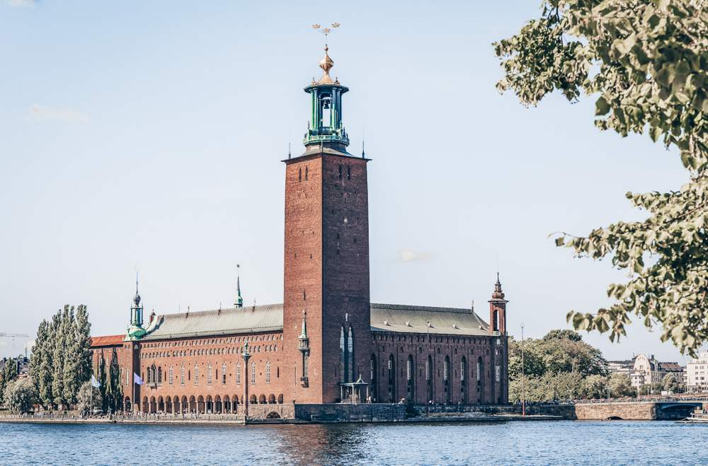 Things to see in Stockholm: View across Lake Malaren onto City Hall on a sunny day