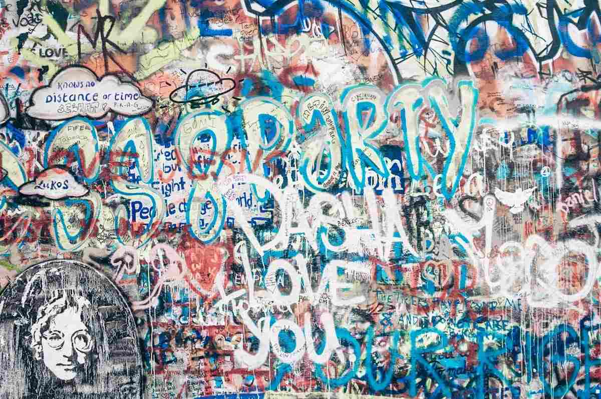 Things to do in Prague: Vivid graffiti scrawled on Lennon Wall, a tribute to John Lennon