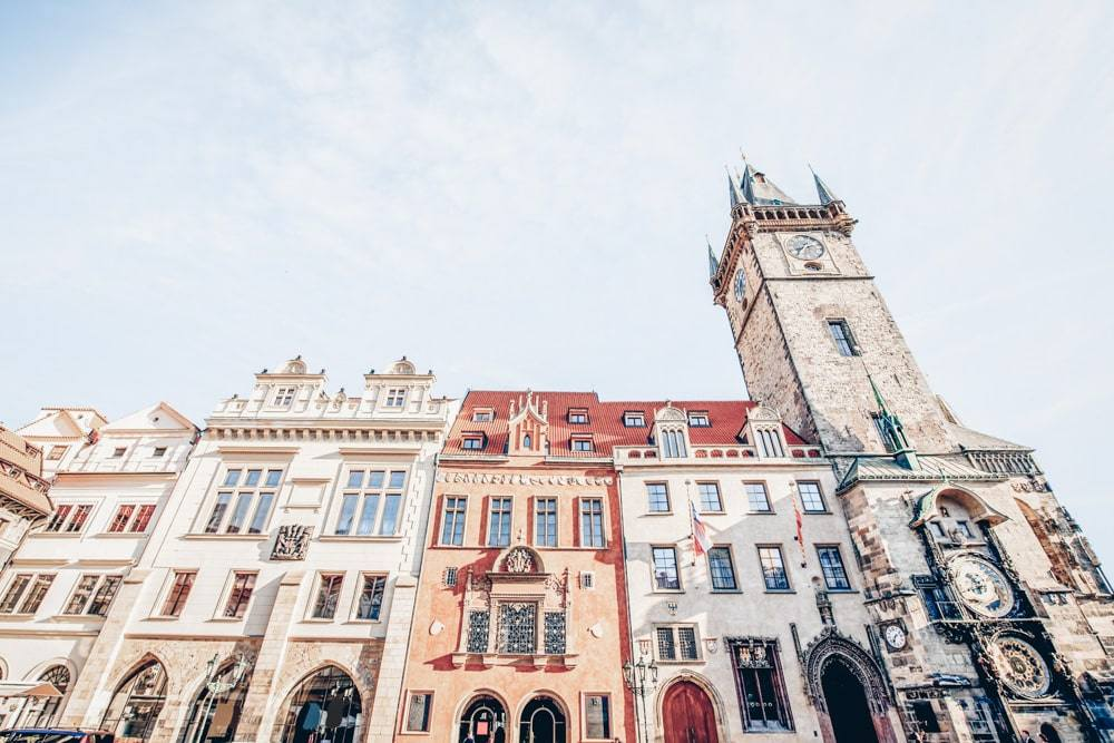 Prague sightseeing: Colorful facades of Gothic and Renaissance merchants' houses of the Old Town Hall