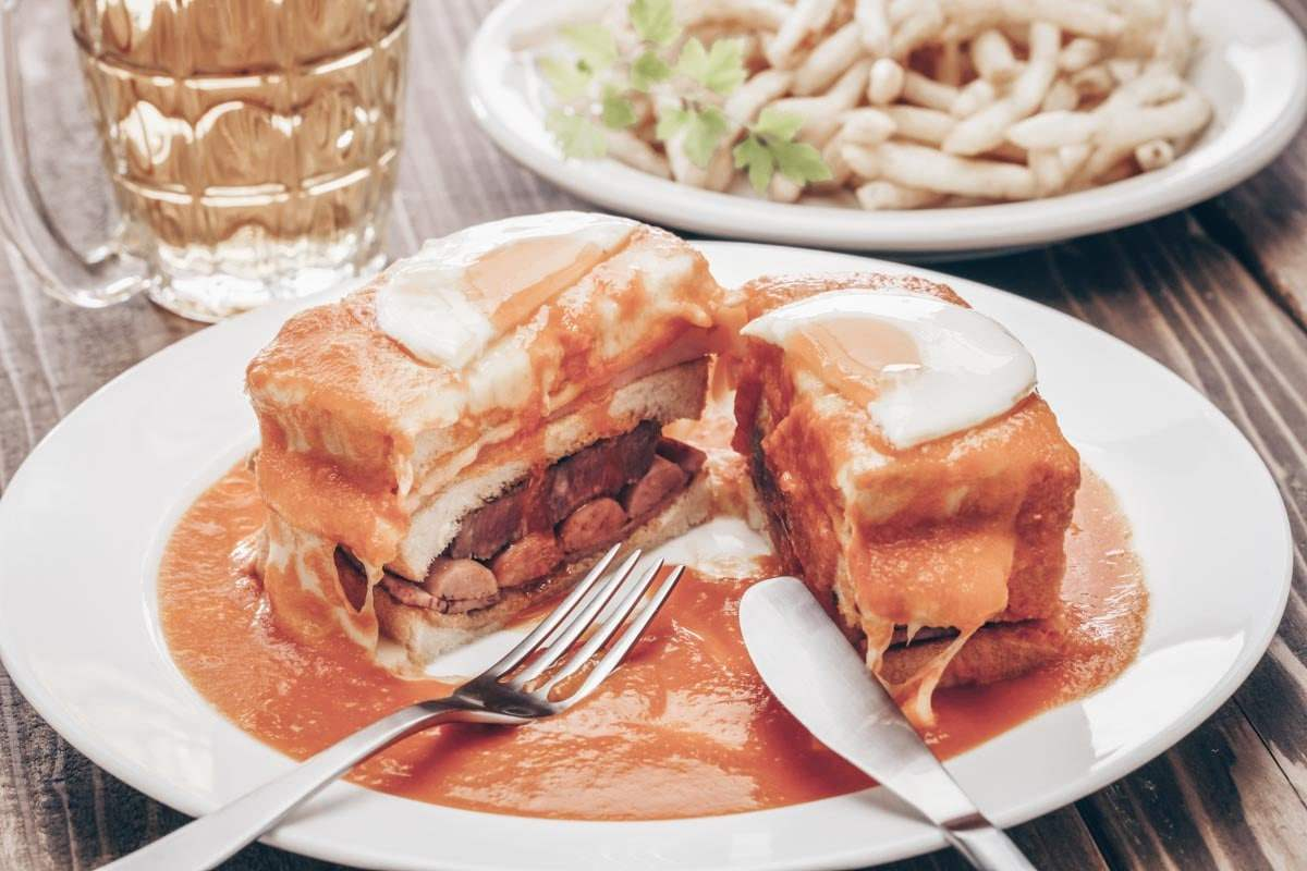 Porto food: Francesinha, a sandwich layered with pork, smoked sausage, bacon, beef and topped with melted cheese
