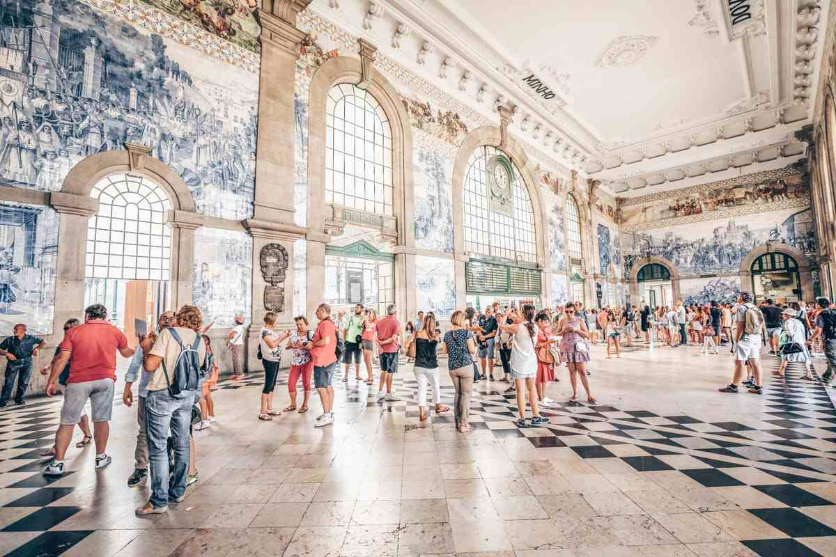 One Day in Porto: People admiring the lavish azulejos in the departure hall of Sao Bento Train Station. PC: Benny Marty/shutterstock.com