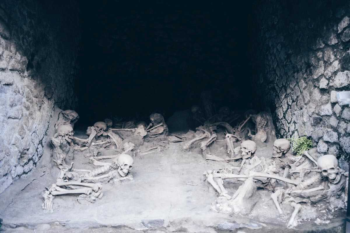 Herculaneum Fornici: Human skeletons inside the arched boat houses.