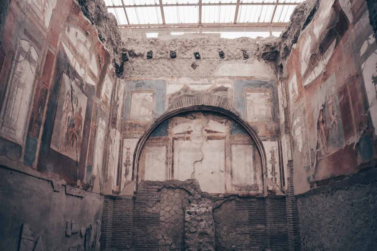 Herculaneum: Well-preserved mythically themed frescoes inside the Hall of the Augustals