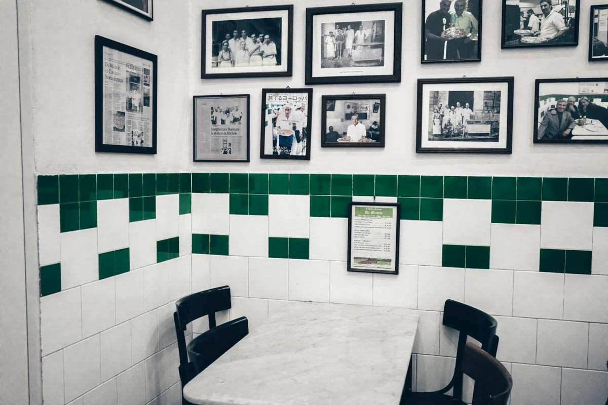 Best pizzeria in Naples: Portraits of famous patrons on the walls of L'Antica Pizzeria Da Michele