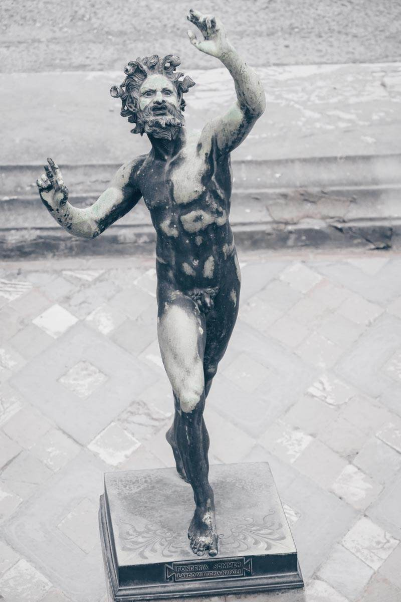 Pompeii House of the Faun: The bronze statue of the Dancing Faun found in the impluvium in the inner courtyard