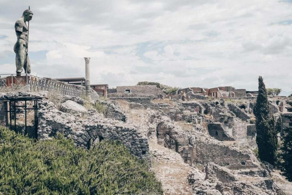 Visit Pompeii: The ruins of Pompeii Archaeological Park on a sunny day.