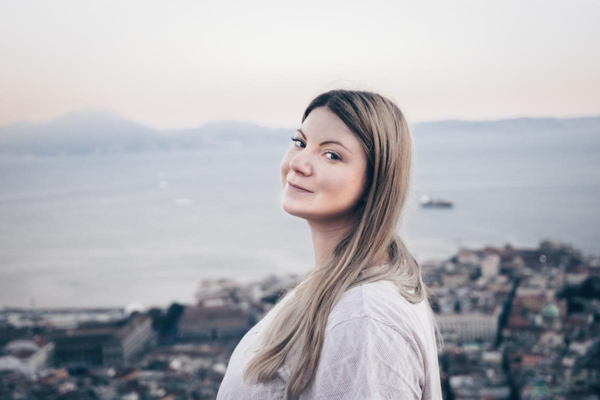 Naples Castel Sant'Elmo: Beautiful woman looking at the camera, with the Bay of Naples in background
