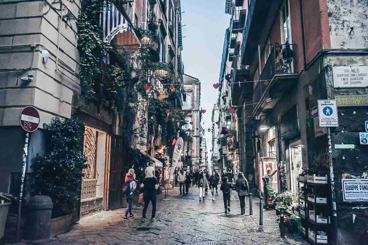 Naples sightseeing: People strolling on the streets in the historic center.
