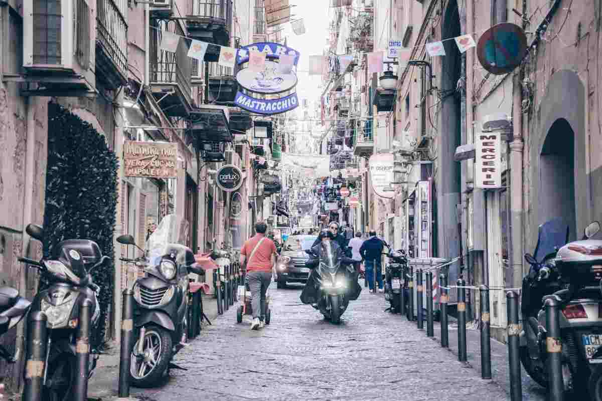 Naples: Traffic moving along a narrow lane in the Spanish Quarter