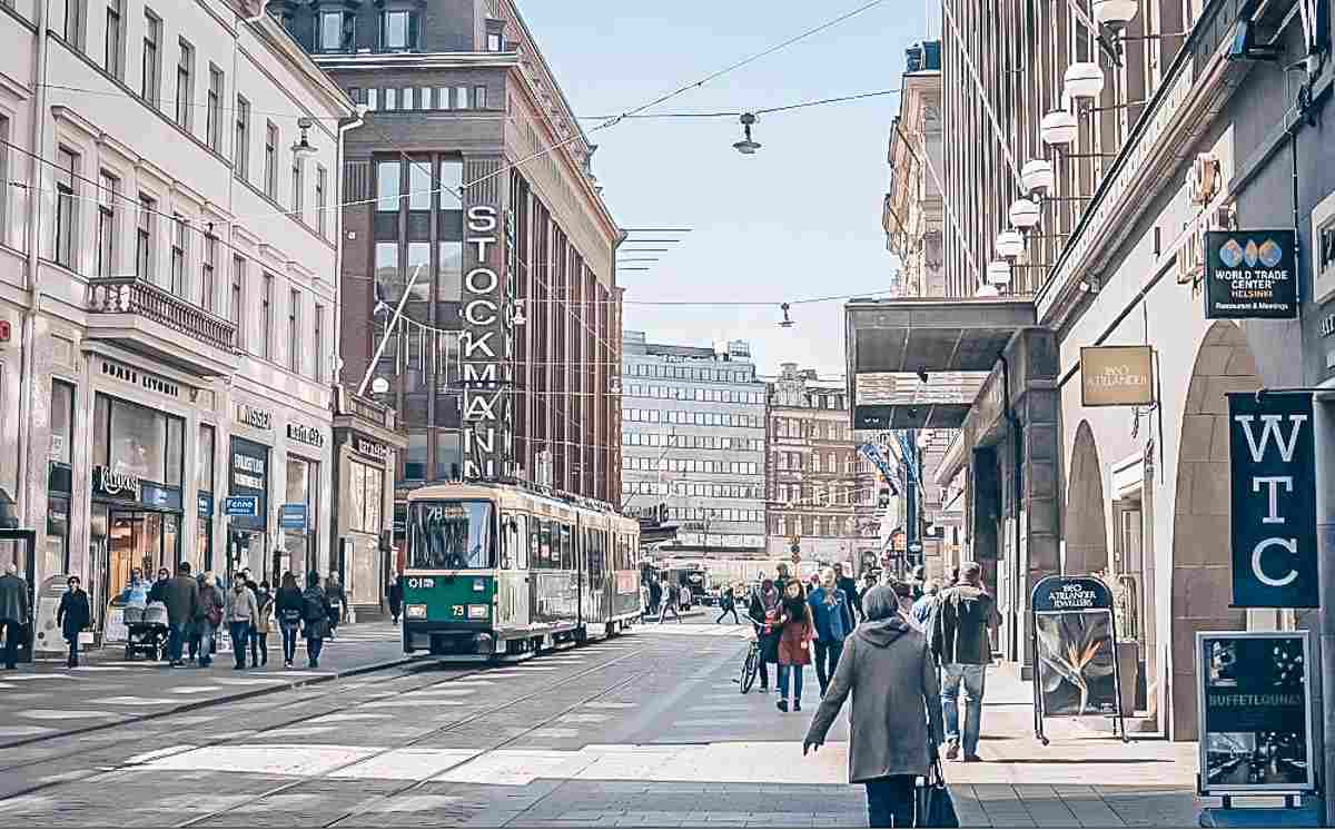 Things to do in Helsinki: People and trams on the commercial shopping street Aleksanterinkatu