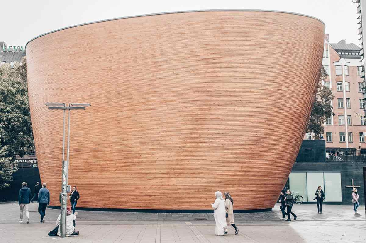 Things to do in Helsinki: Lustrous copper exterior of the oval-shaped Kamppi Chapel of Silence