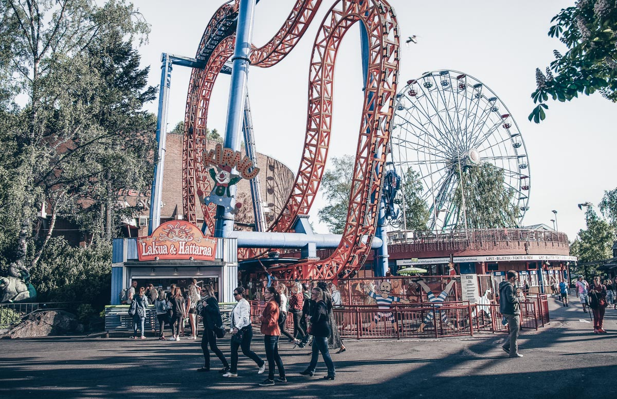 Must-see Helsinki: People, roller-coasters and rides at Linnanmäki Amusement Park. PC: gokhanadiller/shutterstock.com