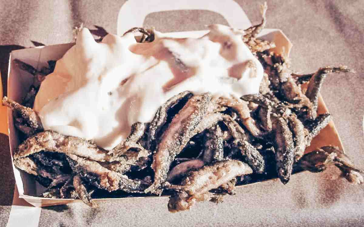 Finnish cuisine: Tiny fried vendace (muikku) covered with mayonnaise