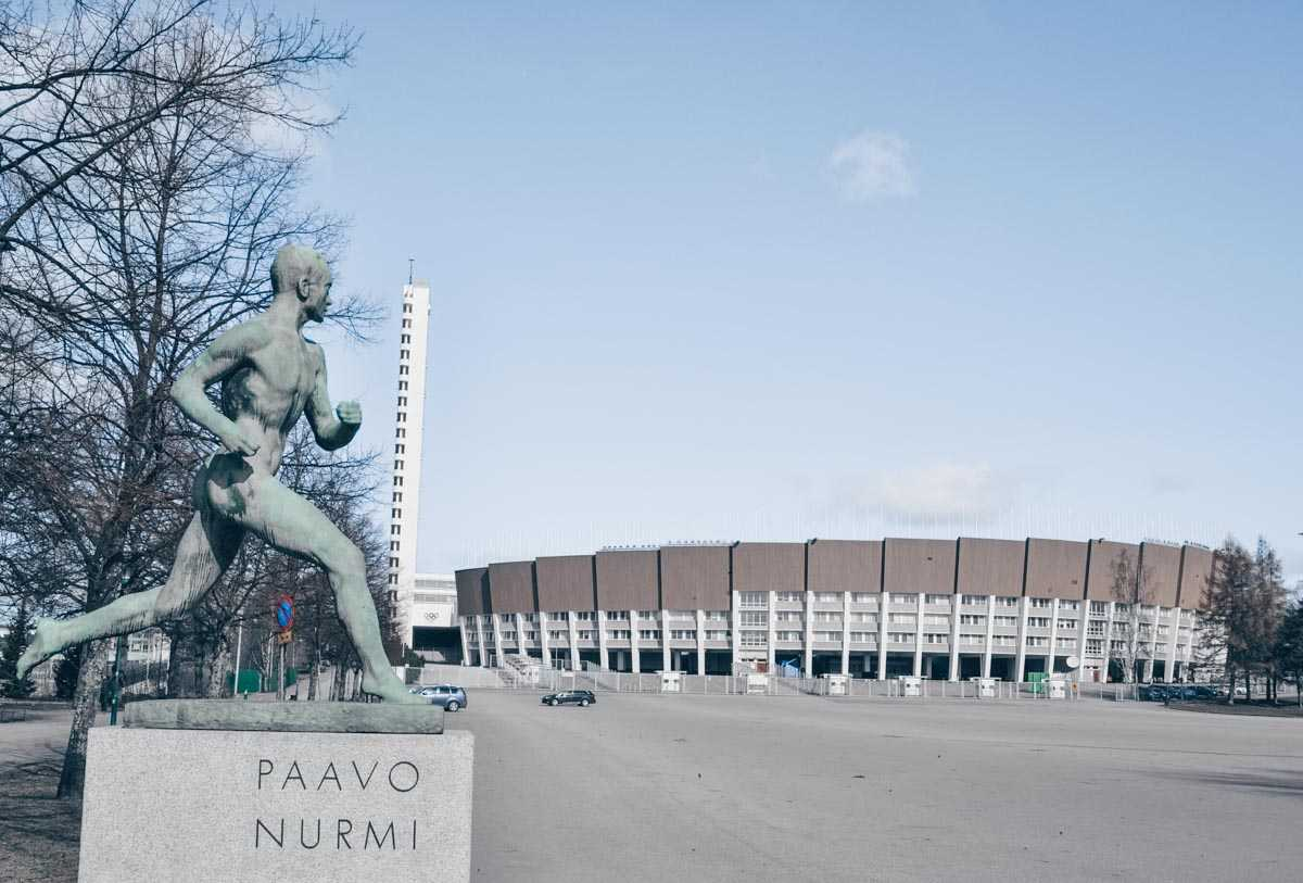 Helsinki attractions: Statue of Paavo Nurmi with the Olympic Stadium in background. PC: S Kozakiewicz/shutterstock.com