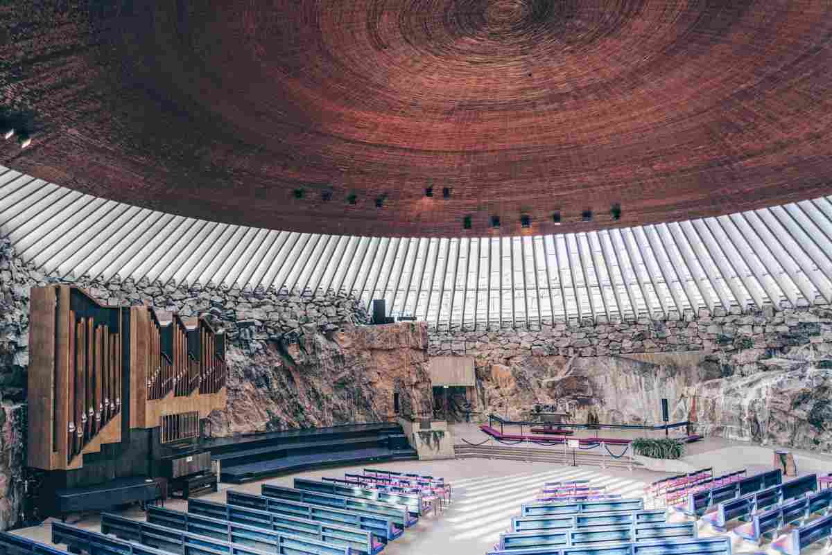 Helsinki Temppeliaukio Church:  Rock walls, ribbed ring of glass, and copper dome of the interior