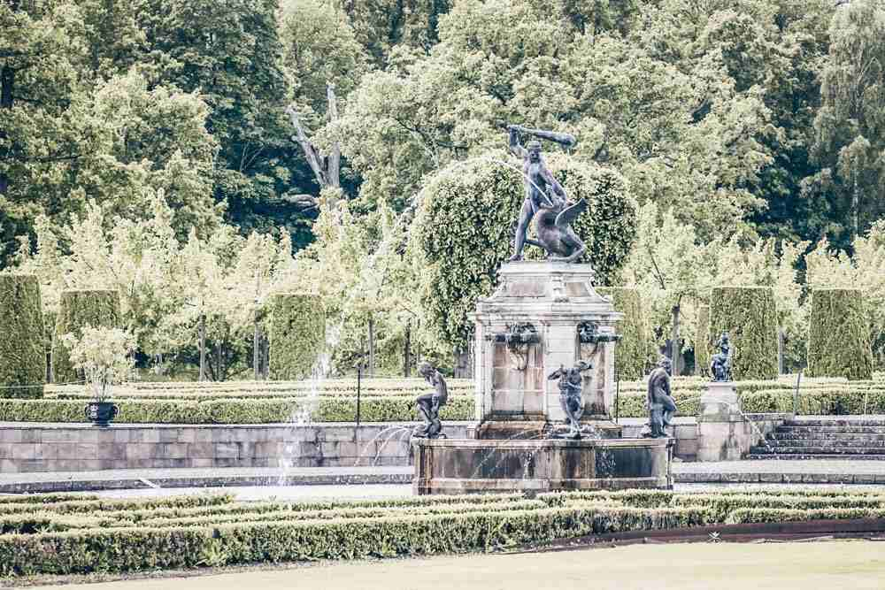 Drottningholm Palace: The Hercules sculpture in the well manicured Baroque gardens