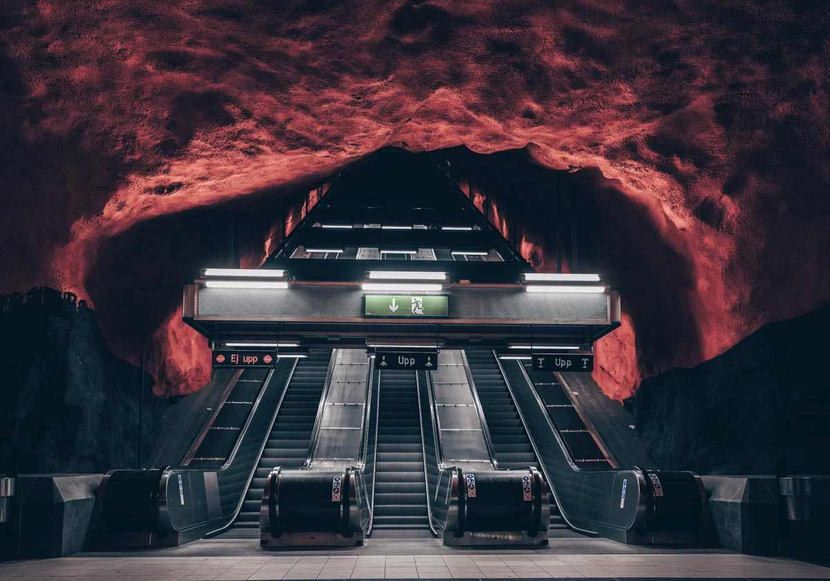 Stockholm Metro: Escalators and the exposed red and black bedrock at Solna Centrum