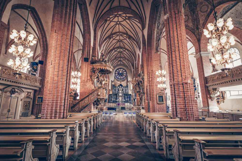 Stockholm Cathedral: The main nave and the red-tiled Gothic interior. PC: Maurizio De Mattei/shutterstock.com