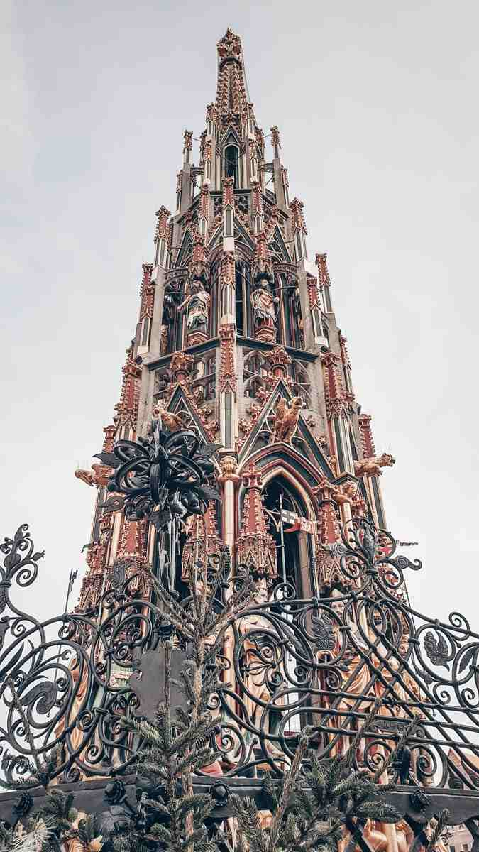 Points of interest in Nuremberg: The intricately carved spire of the Gothic style Beautiful Fountain