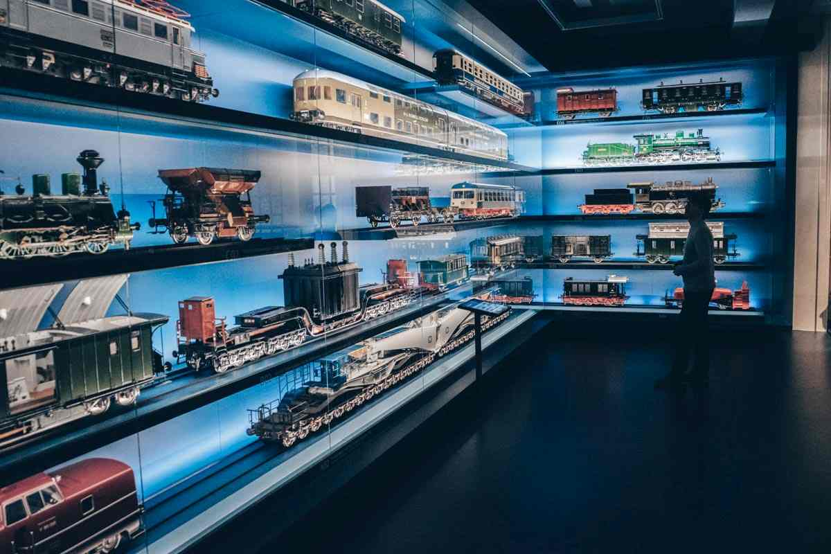 Things to do in Nuremberg: Man observing model trains at the Deutsche Bahn Railway Museum