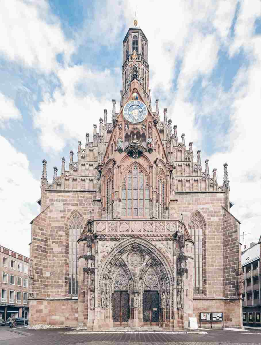 Must-see Nuremberg: The beautiful symmetrical facade of the Gothic Church of Our Lady: PC: Kolossos [CC BY-SA (http://creativecommons.org/licenses/by-sa/3.0/)], via Wikimedia Commons