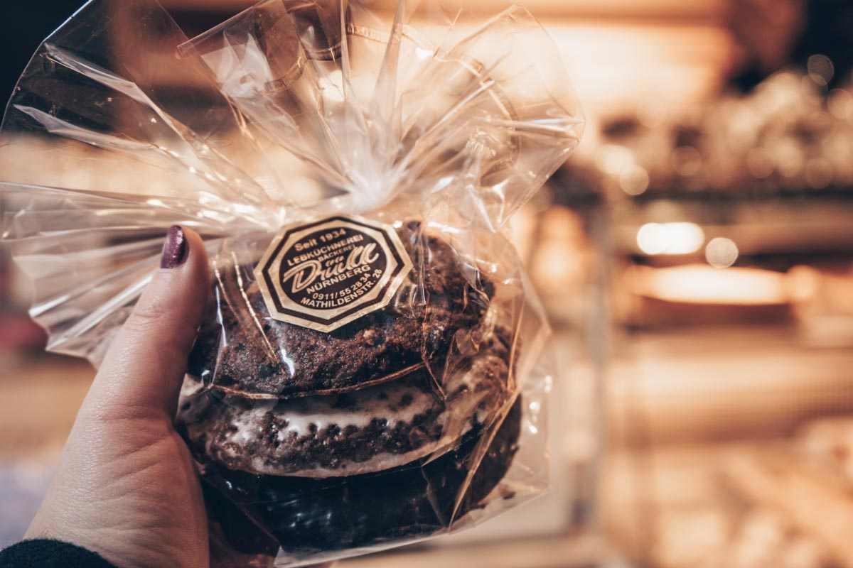 German cuisine: Woman holding a packet of the famous Nuremberg gingerbread (lebkuchen)