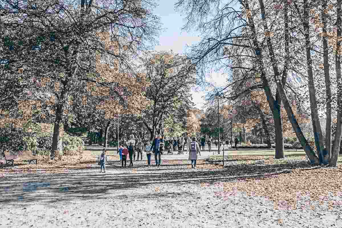 Places to visit in Vilnius: People walking in the lovely Bernardine Garden in autumn