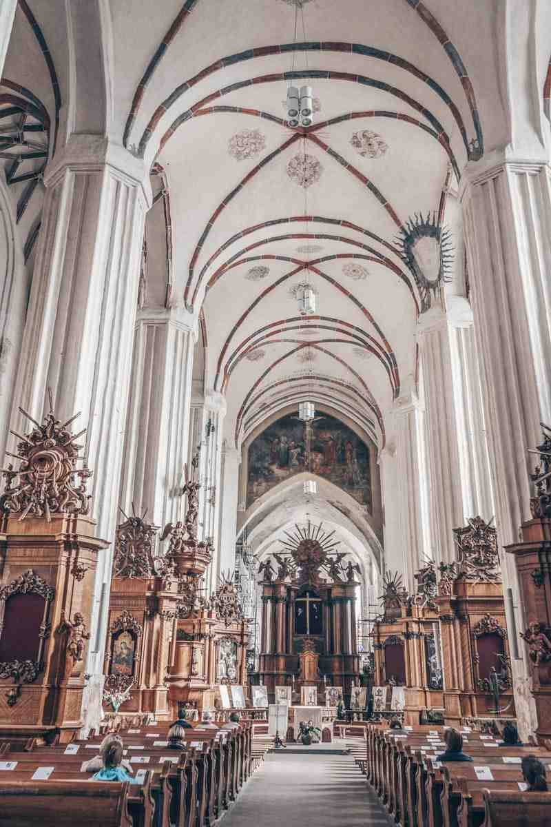 Things to see in Vilnius: Interior of the St. Anne's Church featuring an ensemble of altars