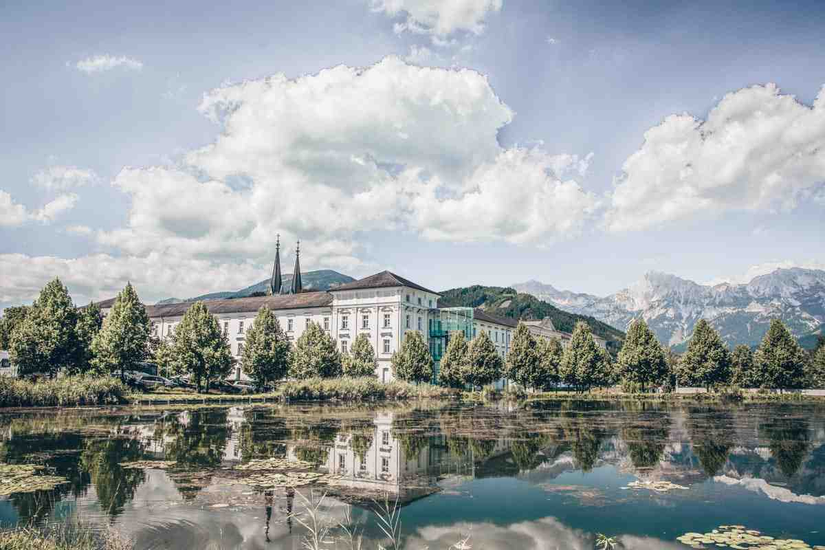 Day Trips From Graz: Exterior of the famous Admont Abbey from across a pond
