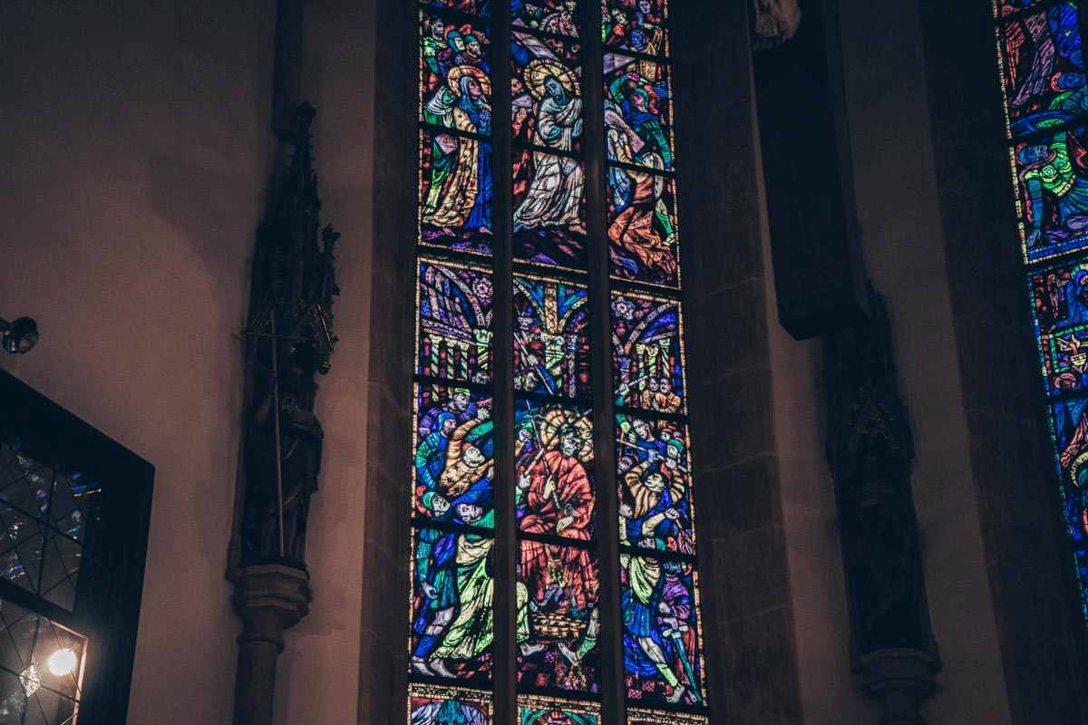 Graz City Parish Church: Stained glass window panel showing Hitler and Mussolini watching over the flagellation of Christ