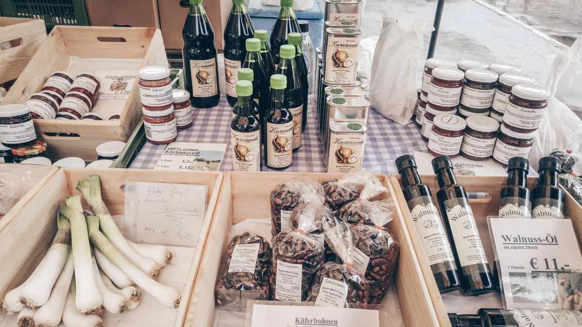 Graz sightseeing: Traditional Styrian food such as pumpkin seed oil and runner beans at the Farmers' Market