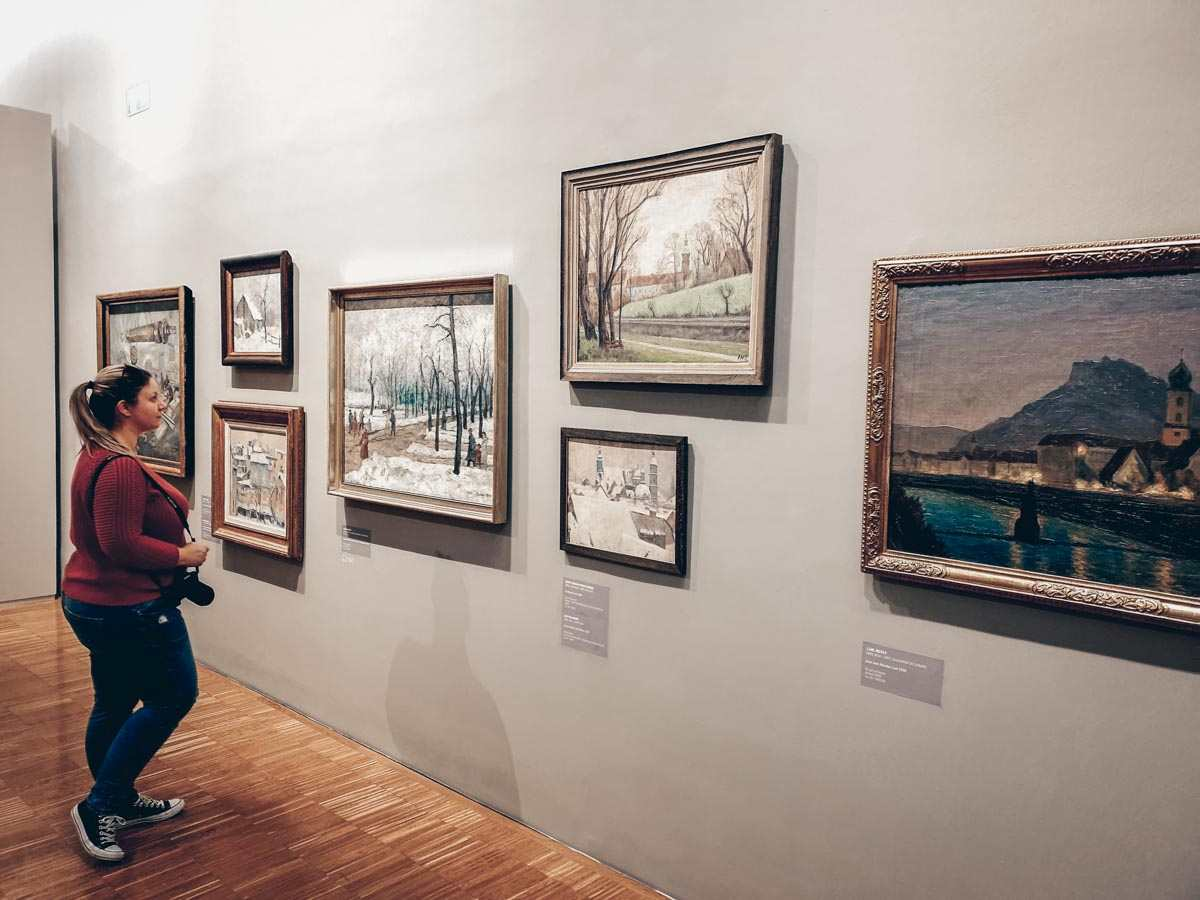 Visit Graz: Beautiful woman admiring the artworks of the New Gallery