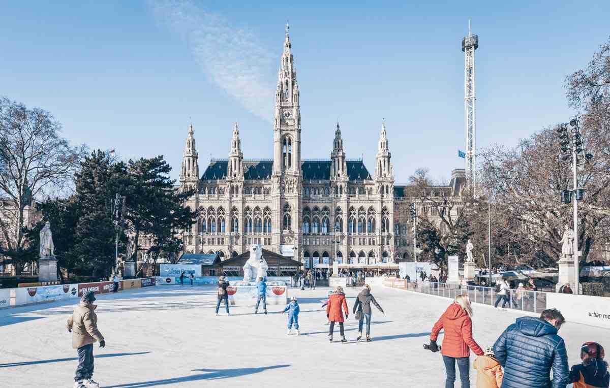 Things to do in Vienna: People skating on the ice rink in front of City Hall. PC: creativemarc/shutterstock.com