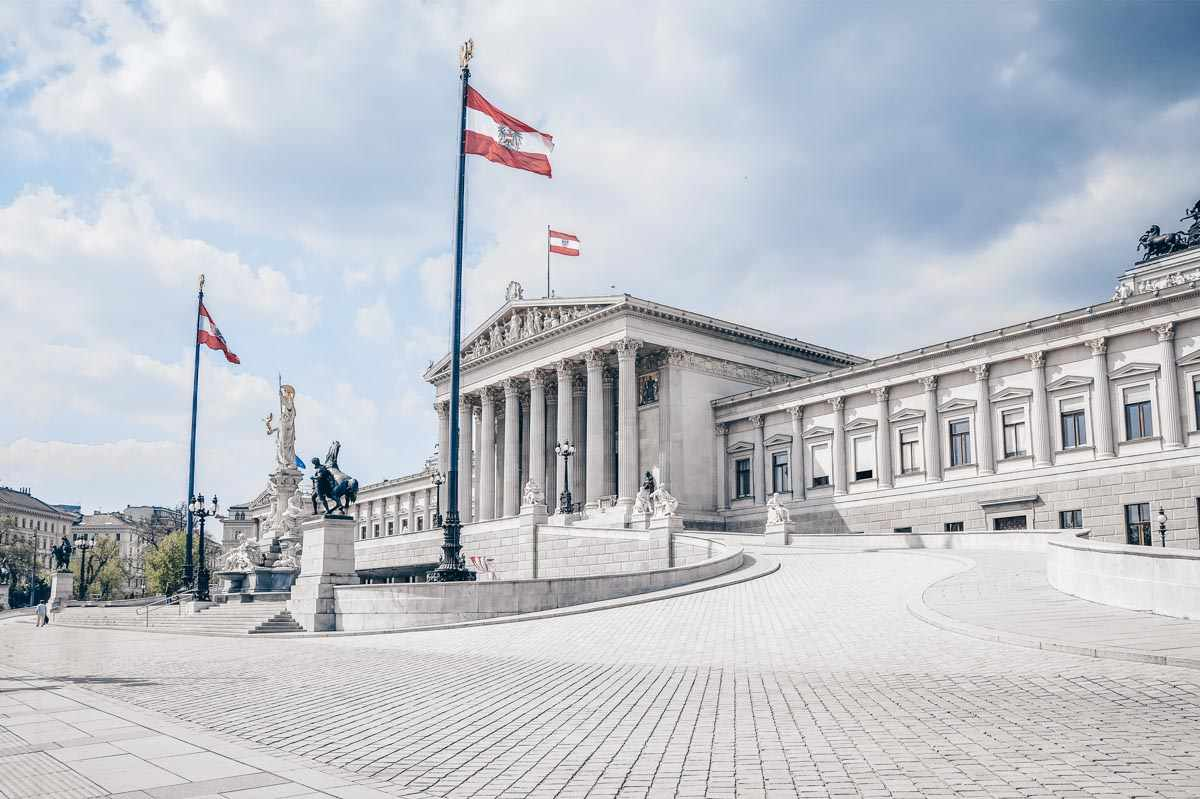 The Neoclassical exterior of the Austrian Parliament Building in Vienna