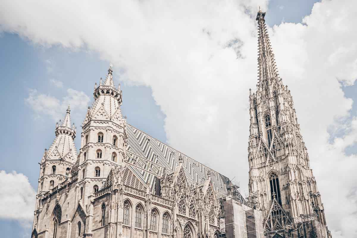 The soaring Gothic spires and tiled roof of St.Stephen's Cathedral in Vienna