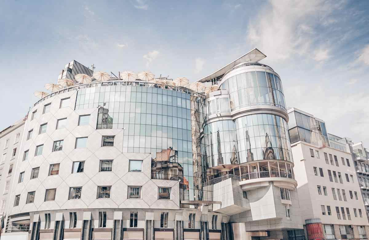 The elegant curved facade of the modernist Haas House in Vienna