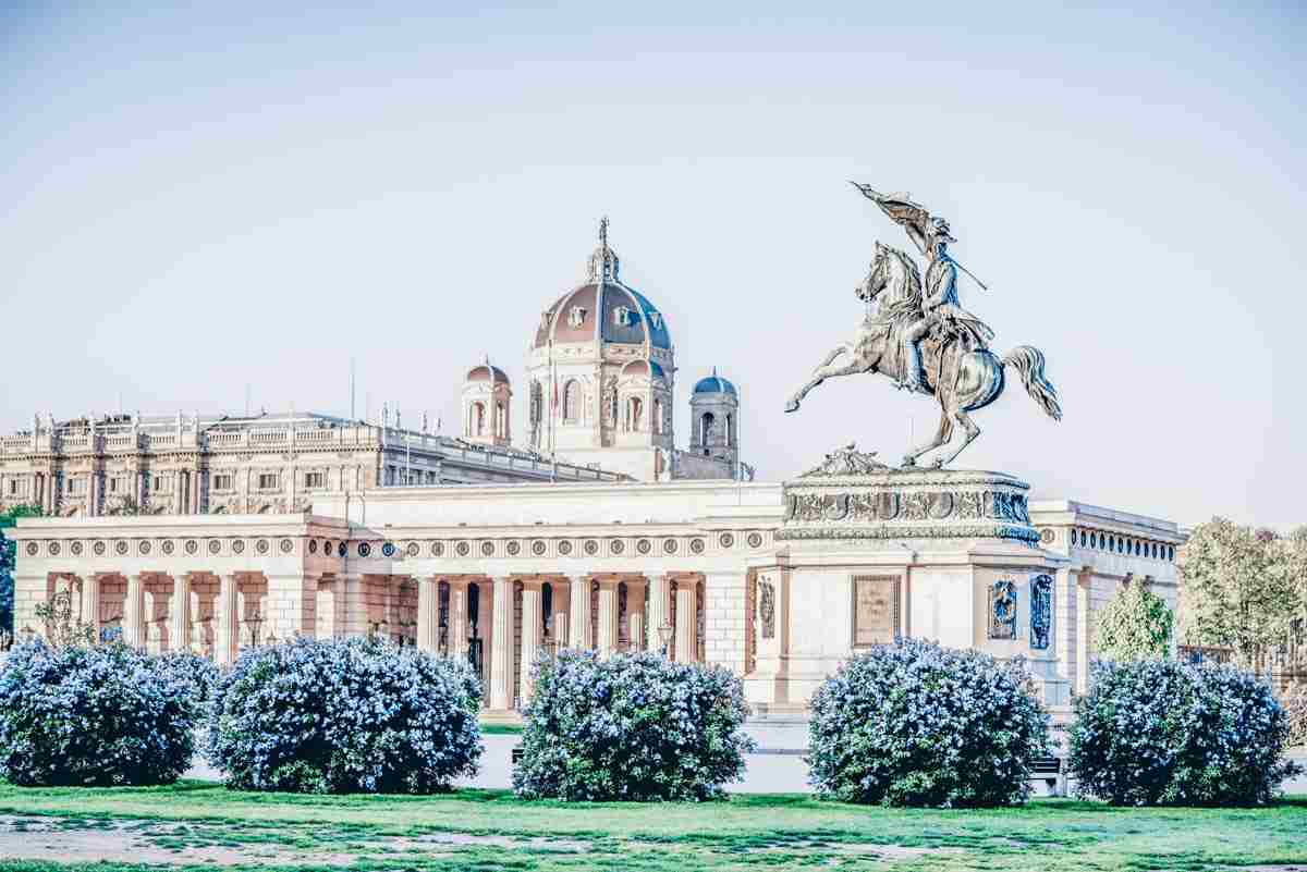 The statue of Archduke Charles in Heroes Square with the Burgtor in the background