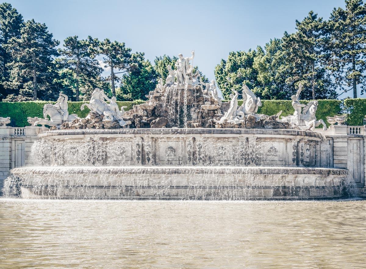 The splendid Baroque-style Neptune Fountain in the Schönbrunn Palace Park