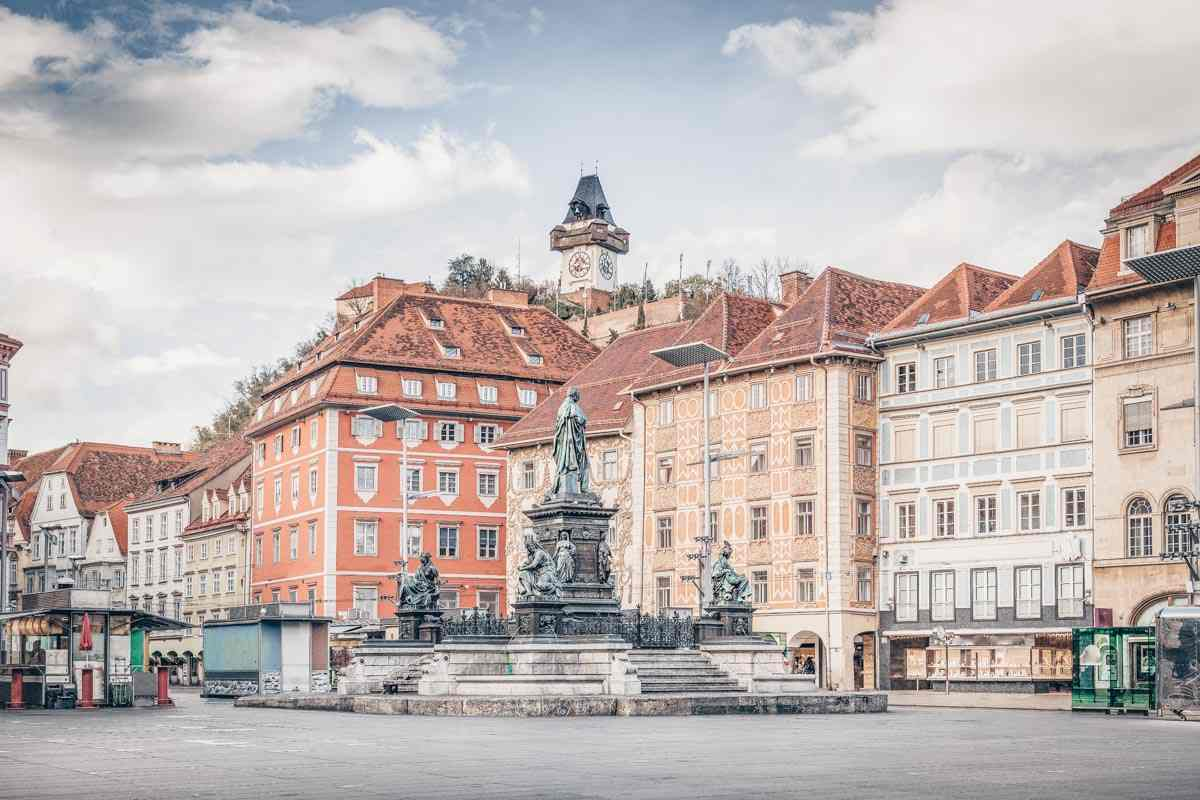 View of the beautiful main square of Graz with the distinctive Clock Tower in background