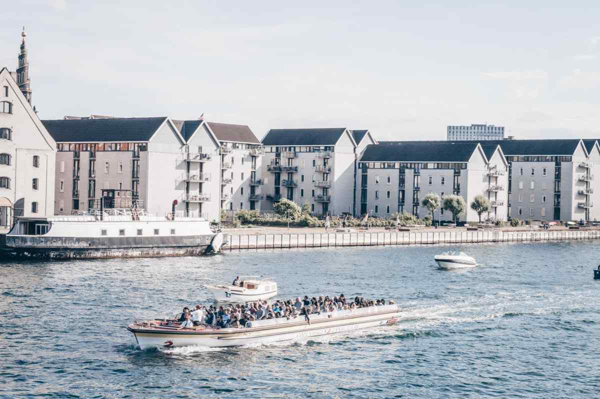 Things to do in Copenhagen: People taking a canal tour in the harbor of Copenhagen