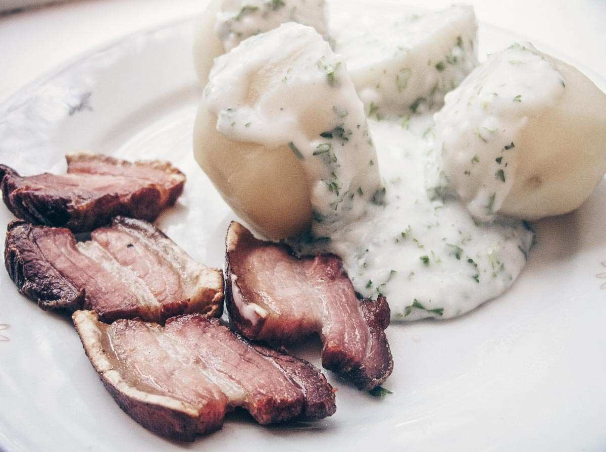 Danish cuisine: Stegt flæsk (fried pork belly served with creamy parsley sauce and potatoes). PC: Nillerdk / CC BY (https://creativecommons.org/licenses/by/3.0), via Wikimedia Commons