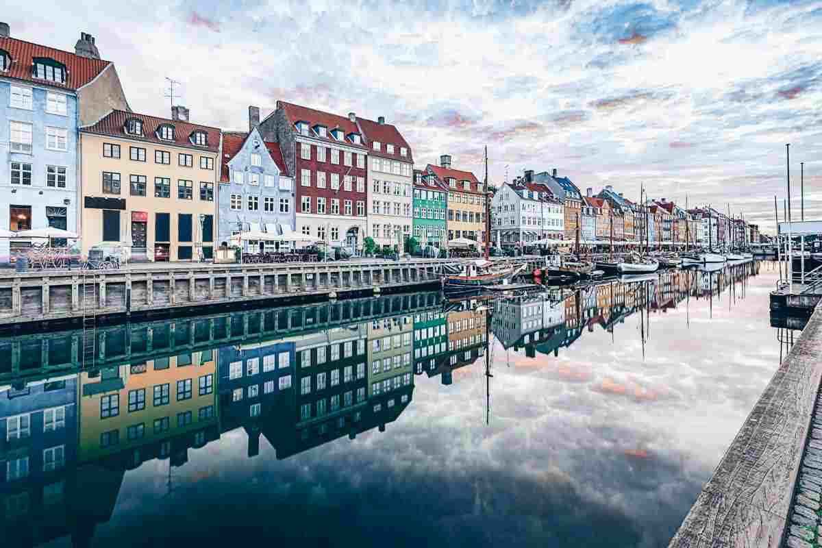 Things to do in Copenhagen: Reflection of colorful buildings in the water at Nyhavn canal