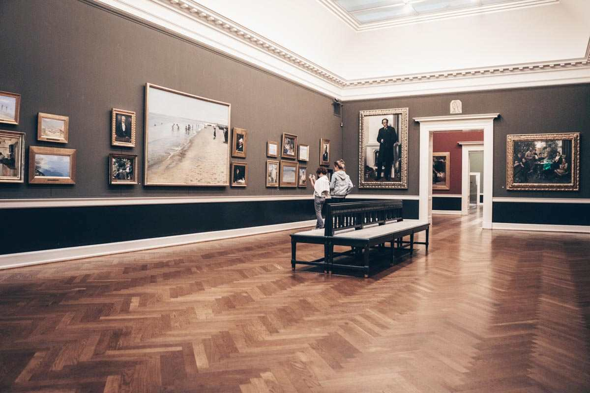 Things to see in Copenhagen: People admiring the impressive paintings of the Hirschsprung Collection