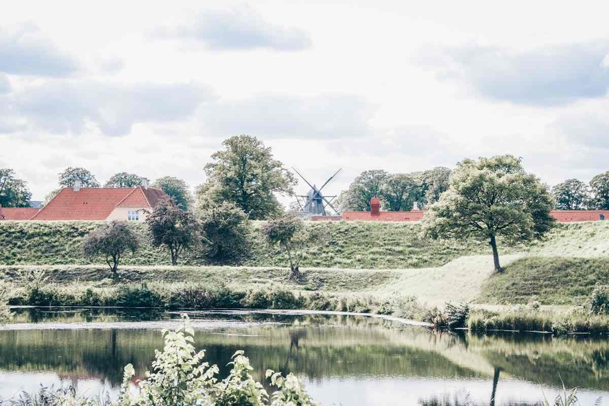 Copenhagen Kastellet: View of the high embankments, moat, and Dutch-style windmill
