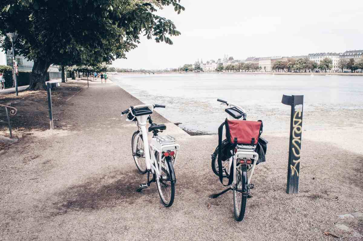 Two bicycles parked along the bank of the Copenhagen Lakes