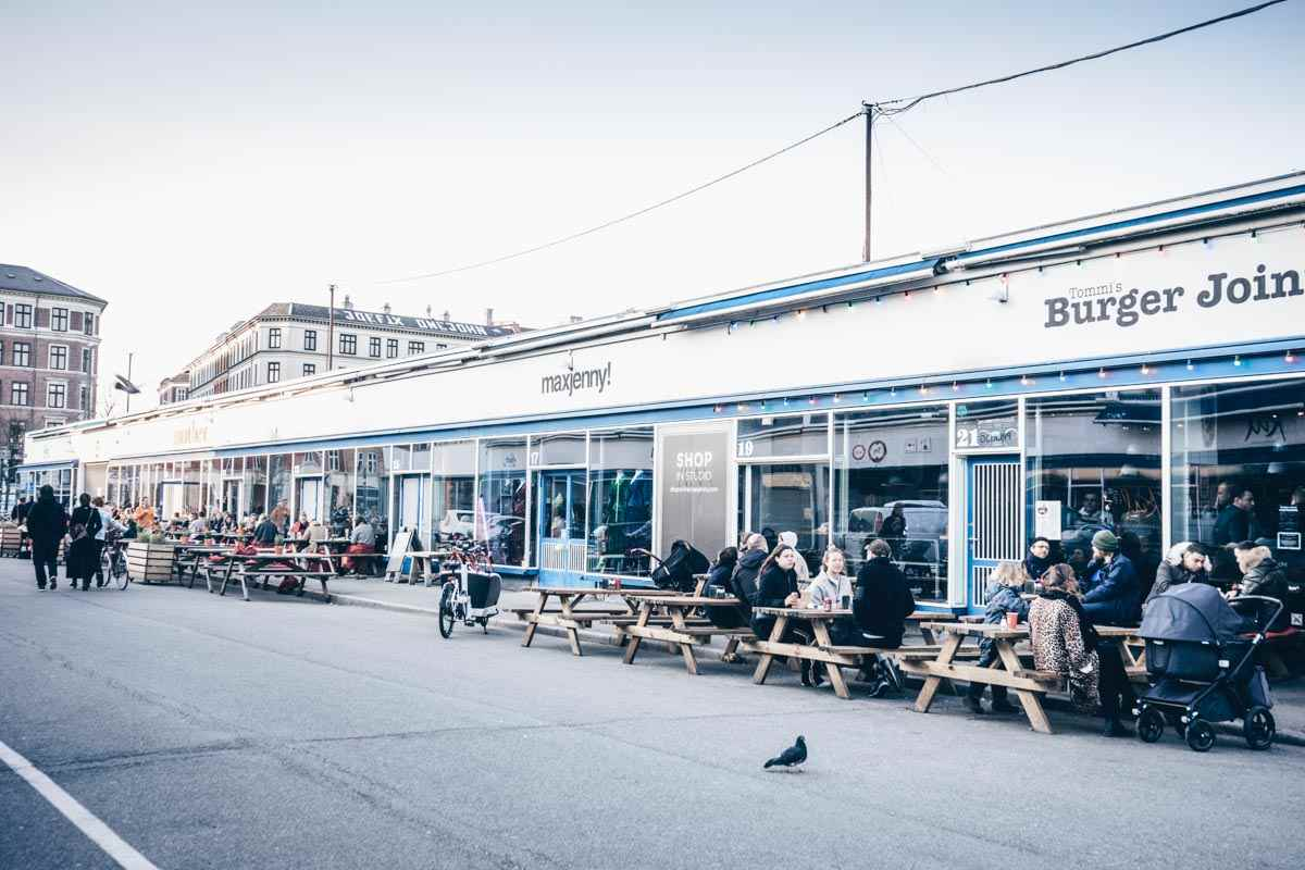 Copenhagen Meatpacking District: People dining on outdoor tables at restaurants