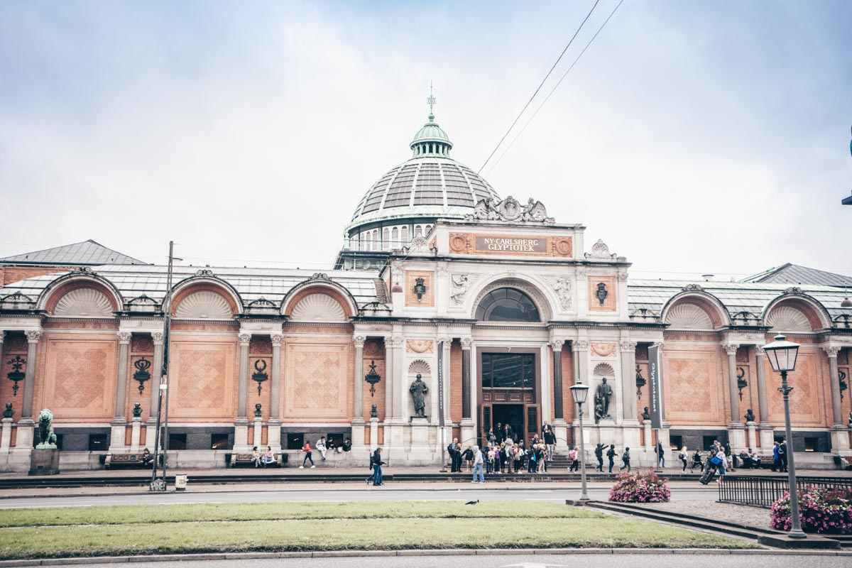 Things to do in Copenhagen: Copper and glass-domed exterior of the Ny Carlsberg Glyptotek Museum