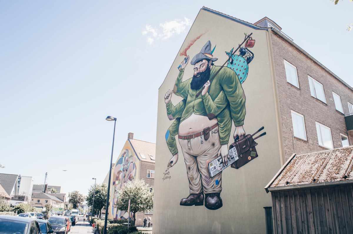 Copenhagen Street Art: Colorful murals painted on the sides of buildings in Nørrebro