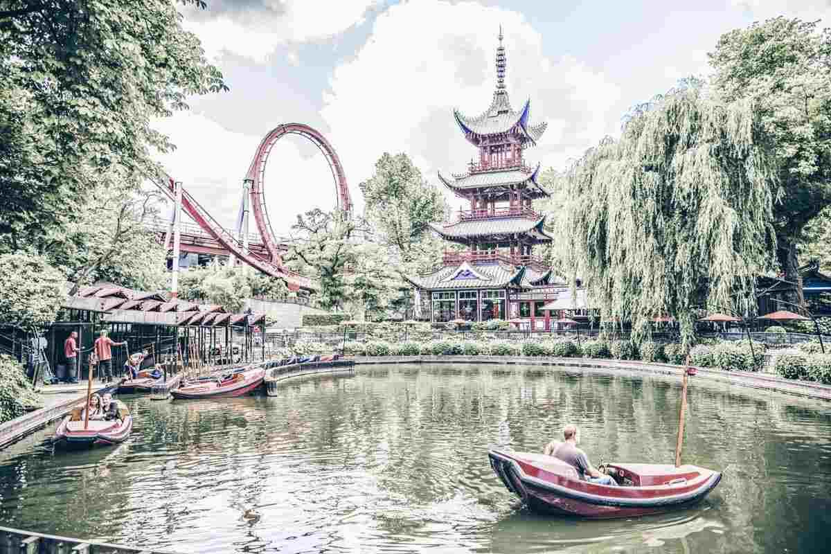 Copenhagen Tivoli Gardens: View of Tivoli lake, rollercoasters and Japanese pagoda. PC: Sun_Shine/shutterstock.com